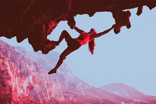Woman rock climbing image